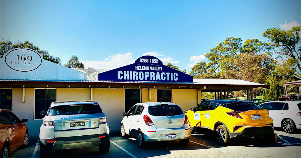Signage of chiropractic care, massage and homeopathy centre with blue sky